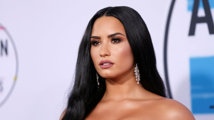 FILE PHOTO: Singer and actress Demi Lovato arrives at the 2017 American Music Awards in Los Angeles, California, U.S., November 19, 2017.   REUTERS/Danny Moloshok/File Photo