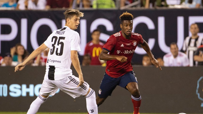FC Bayern's Kingsley Coman, right, and Juventus' Leonardo Loria, left, go after the ball during the second half of an International Champions Cup tournament soccer match Wednesday, July 25, 2018, in Philadelphia. Juventus won 2-0. (AP Photo/Chris Szagola)